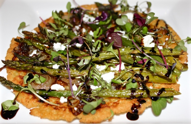 Socca with Carmelized Onion, Asparagus & Sprouts